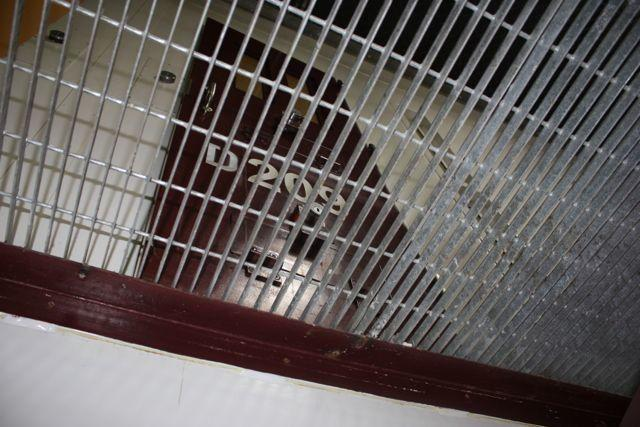 The second level of an empty cell block in Camp VI as seen from below.