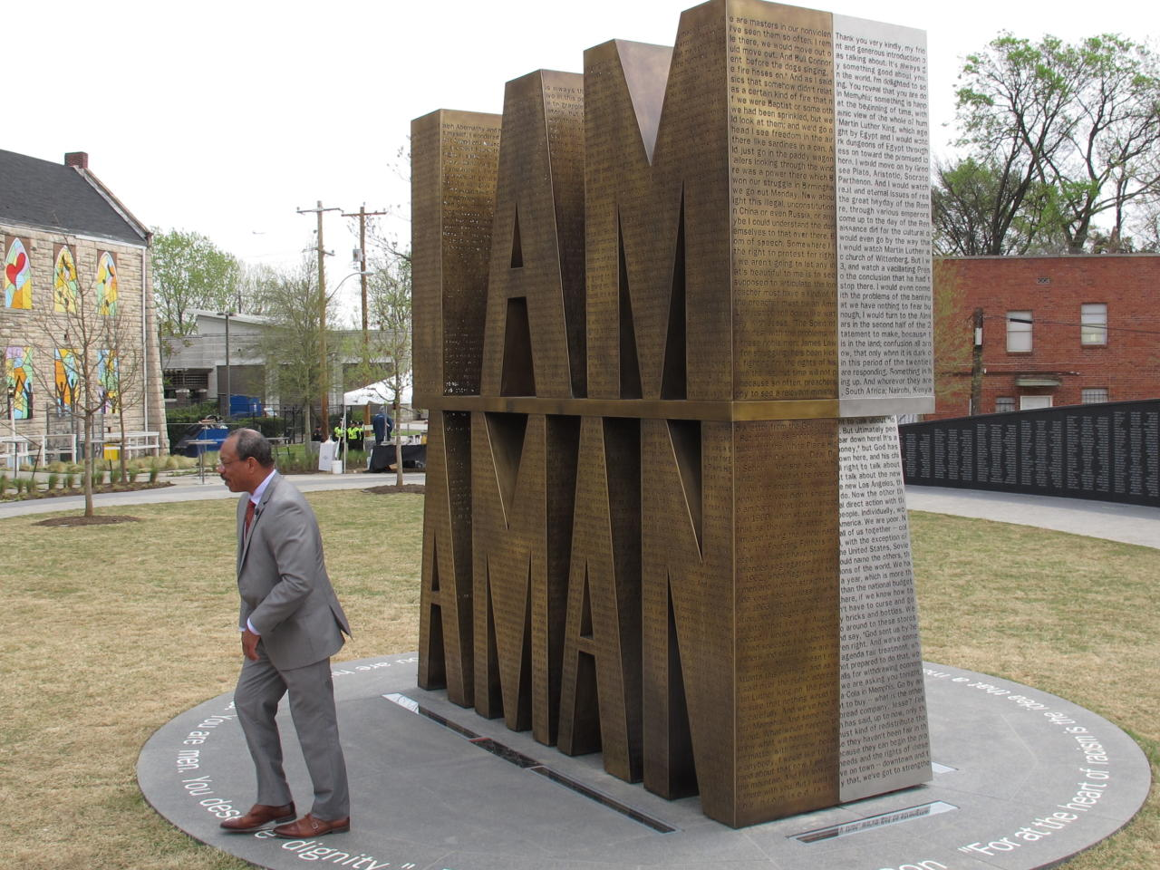 A bronze and steel sculpture honoring a sanitation workers strike that brought the Rev. Martin Luther King Jr. to Memphis in 1968 was dedicated on Thursday, April 5, 2018, in Memphis, Tenn. The memorial sits at I Am A Man Plaza next to the Clayborn Temple, which served as the headquarters of the strike. (AP Photo/Adrian Sainz).