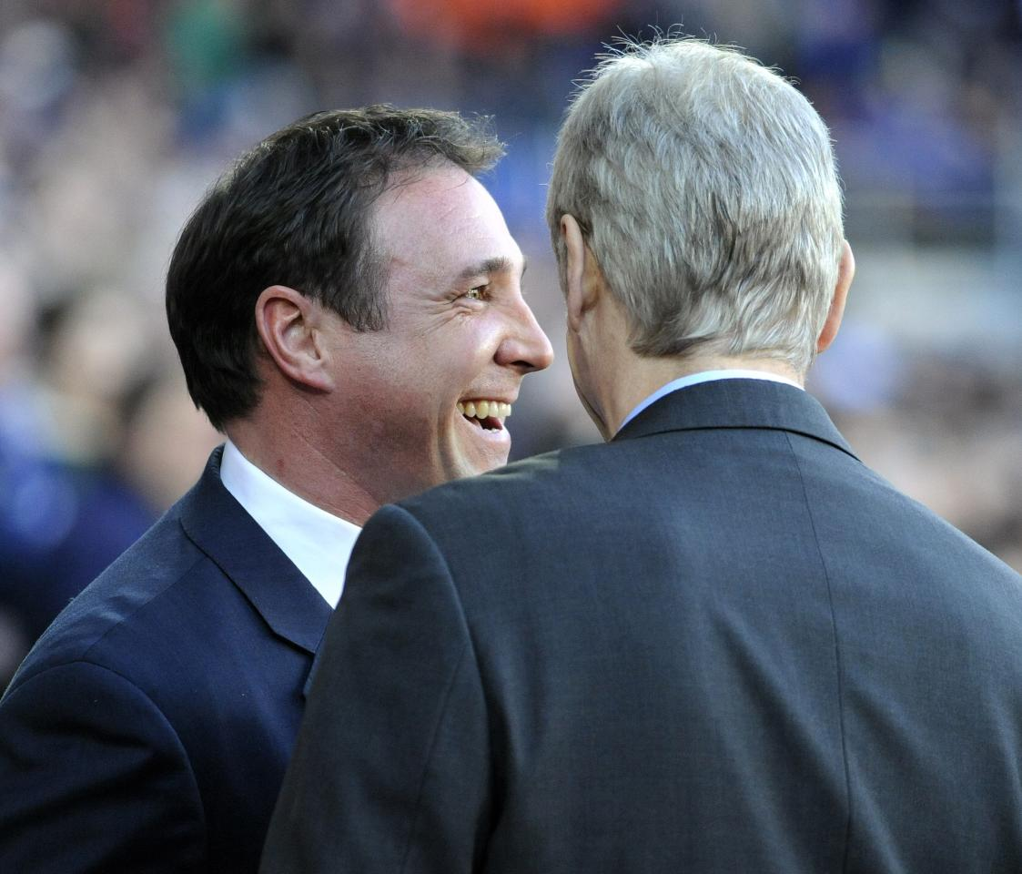 "Cardiff City's manager Malky Mackay (L) talks to Arsenal's manager Arsene Wenger before kick off, during their English Premier League soccer match at Cardiff City Stadium in Cardiff, Wales, November 30, 2013. REUTERS/Rebecca Naden (BRITAIN - Tags: SPORT SOCCER) NO USE WITH UNAUTHORIZED AUDIO, VIDEO, DATA, FIXTURE LISTS, CLUB/LEAGUE LOGOS OR ""LIVE"" SERVICES. ONLINE IN-MATCH USE LIMITED TO 45 IMAGES, NO VIDEO EMULATION. NO USE IN BETTING, GAMES OR SINGLE CLUB/LEAGUE/PLAYER PUBLICATIONS. FOR EDITORIAL USE ONLY. NOT FOR SALE FOR MARKETING OR ADVERTISING CAMPAIGNS"