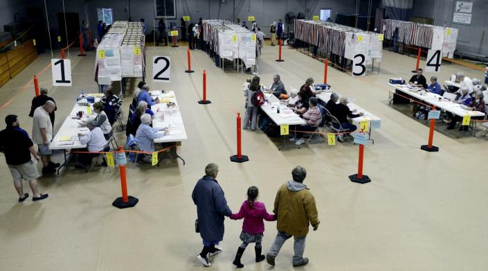 """<span class=""""caption"""">With its largely white and older workers, this poll site in Maine is typical of poll sites across the U.S.</span> <span class=""""attribution""""><a class=""""link rapid-noclick-resp"""" href=""""https://www.gettyimages.com/detail/news-photo/poll-workers-check-in-voters-as-they-make-their-way-to-the-news-photo/495619496?adppopup=true"""" rel=""""nofollow noopener"""" target=""""_blank"""" data-ylk=""""slk:Shawn Patrick Ouellette/Portland Portland Press Herald via Getty Images"""">Shawn Patrick Ouellette/Portland Portland Press Herald via Getty Images</a></span>"""