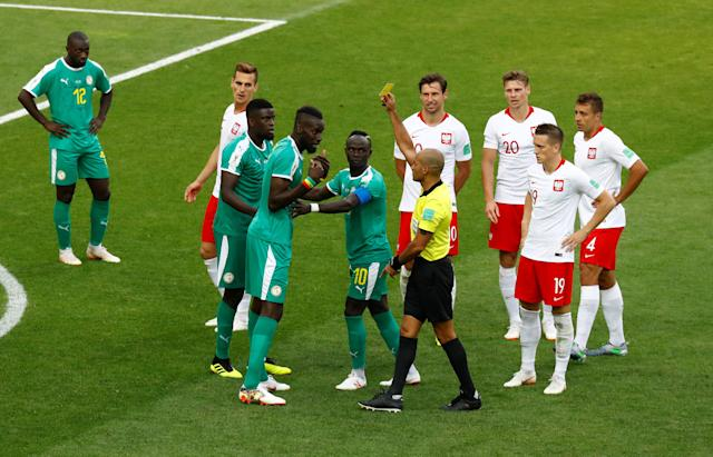 Soccer Football - World Cup - Group H - Poland vs Senegal - Spartak Stadium, Moscow, Russia - June 19, 2018 Senegal's Salif Sane is booked by referee Nawaf Shukralla REUTERS/Kai Pfaffenbach