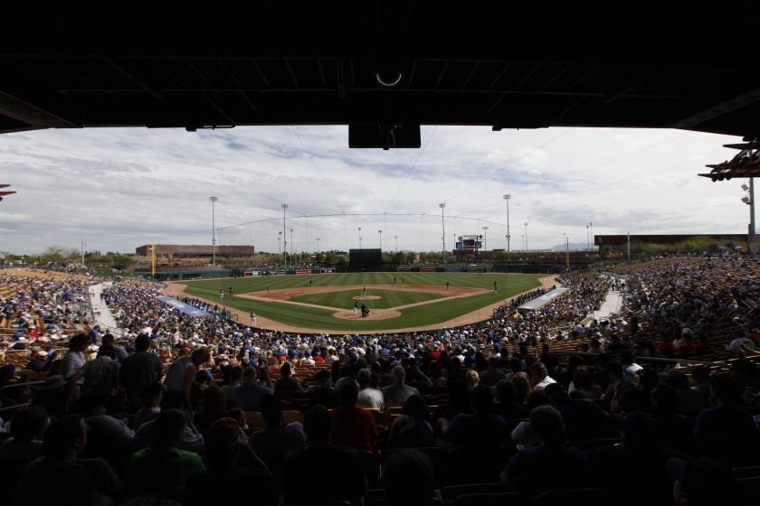 Fans watch an exhibition baseball game at Camelback Ranch between the Los Angeles Dodgers and Chicago White Sox in Glendale, Ariz., Friday, Feb. 28, 2014. (AP Photo/Paul Sancya)