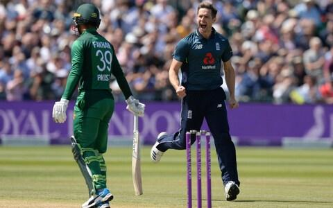 Chris Woakes of England celebrates after dismissing Fakhar Zaman of Pakistan during the third one-day international between England and Pakistan at the County Ground on May 14, 2019 in Bristol, England - Credit: Popperfoto