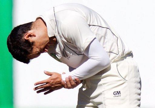 Ross Taylor of New Zealand reacts in agony after being hit on the wrist by the ball during day four of the Test against South Africa at the Basin Reserve in Wellington