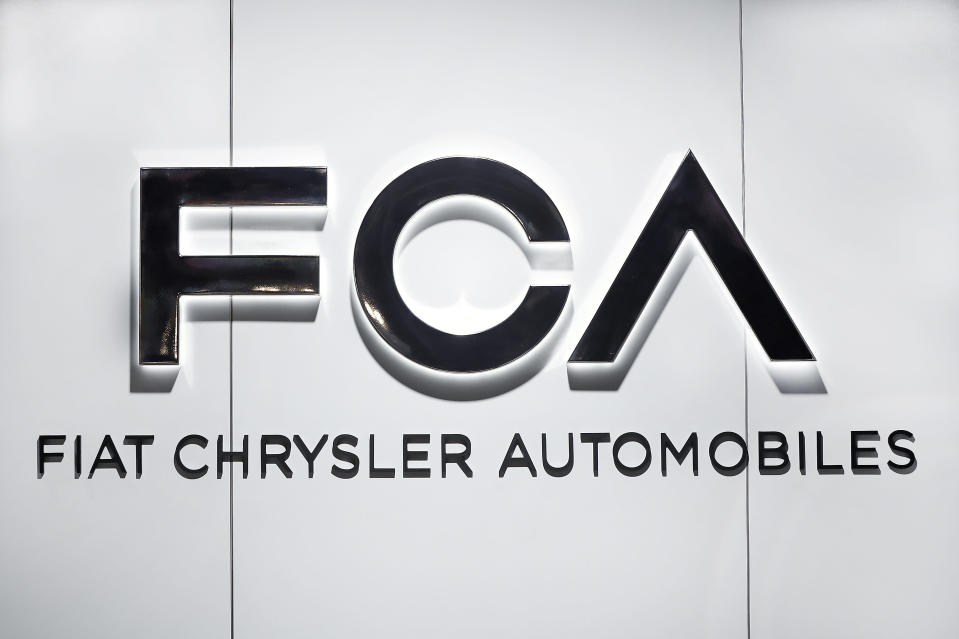 "FILE - In this Monday, Jan. 14, 2019 file photo, Fiat Chrysler Automobiles FCA logo is shown at the North American International Auto Show in Detroit. Fiat Chrysler Automobiles is denying allegations by General Motors that FCA used foreign bank accounts to bribe union officials so they would stick GM with higher labor costs. In court papers filed Monday, Aug. 10, 2020 the Italian-American automaker said GM was using court records to make ""defamatory and baseless"" claims. (AP Photo/Paul Sancya, file)"