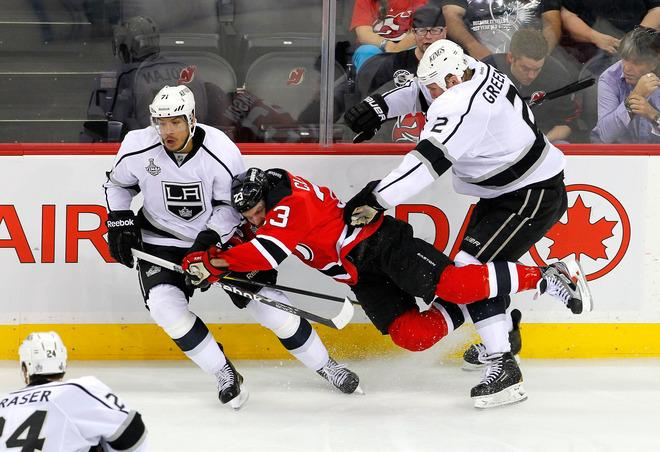 NEWARK, NJ - JUNE 02: David Clarkson #23 of the New Jersey Devils draws contact from Matt Greene #2 and Jordan Nolan #71 of the Los Angeles Kings during Game Two of the 2012 NHL Stanley Cup Final at the Prudential Center on June 2, 2012 in Newark, New Jersey.  (Photo by Paul Bereswill/Getty Images)