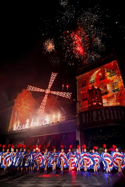 Red, white and blue fireworks accompanied the Moulin Rouge dancers as they performed an open-air can-can