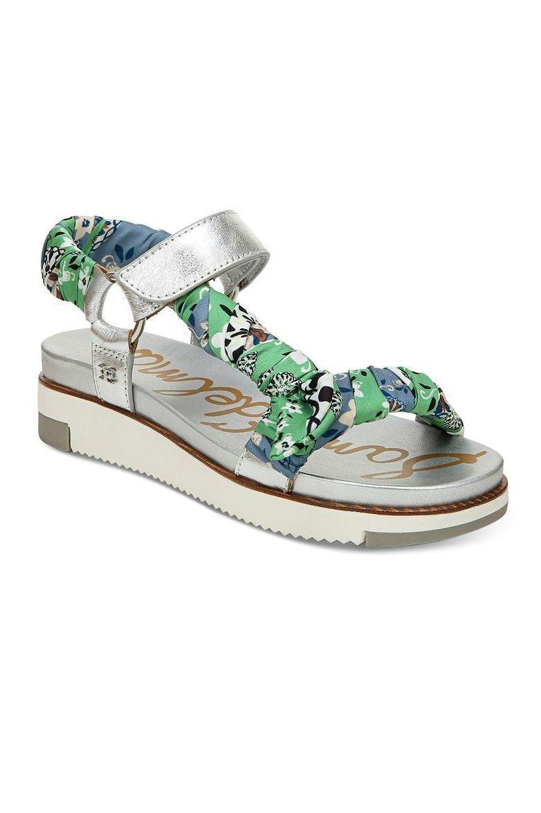 """<p><strong>Sam Edelman</strong></p><p>bloomingdales.com</p><p><strong>$131.00</strong></p><p><a href=""""https://go.redirectingat.com?id=74968X1596630&url=https%3A%2F%2Fwww.bloomingdales.com%2Fshop%2Fproduct%2Fsam-edelman-womens-ashie-platform-sandals%3FID%3D3786678&sref=https%3A%2F%2Fwww.marieclaire.com%2Ffashion%2Fg34126792%2Fspring-shoe-trends-2021%2F"""" rel=""""nofollow noopener"""" target=""""_blank"""" data-ylk=""""slk:Shop Now"""" class=""""link rapid-noclick-resp"""">Shop Now</a></p><p>These silk-scarf wrapped metallic numbers are the perfect combination of statement-making and the right amount of chill.</p>"""