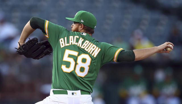 Oakland Athletics pitcher Paul Blackburn works against the Cleveland Indians during the first inning of a baseball game Friday, June 29, 2018, in Oakland, Calif. (AP Photo/Ben Margot)