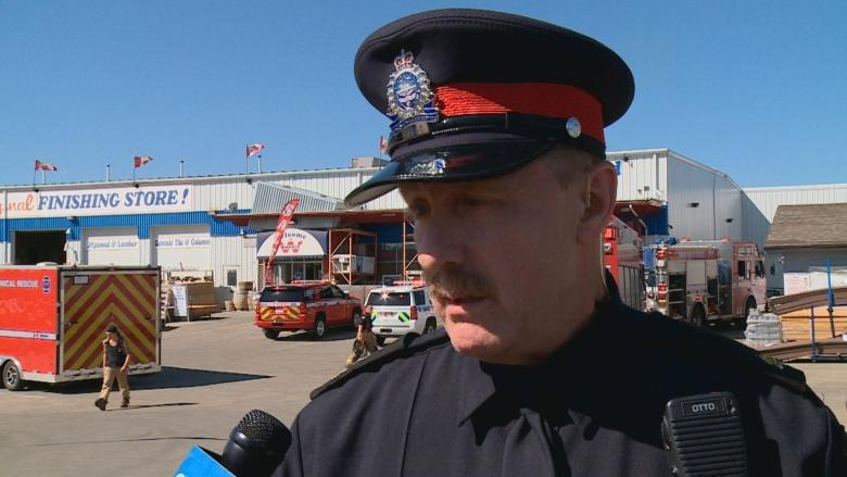 Toppled shelves trap, injure 4 workers at northeast Edmonton building supply company