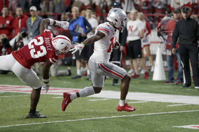Ohio State wide receiver K.J. Hill (14) runs for a touchdown in front of Nebraska cornerback Dicaprio Bootle (23) during the first half of an NCAA college football game in Lincoln, Neb., Saturday, Sept. 28, 2019. (AP Photo/Nati Harnik)