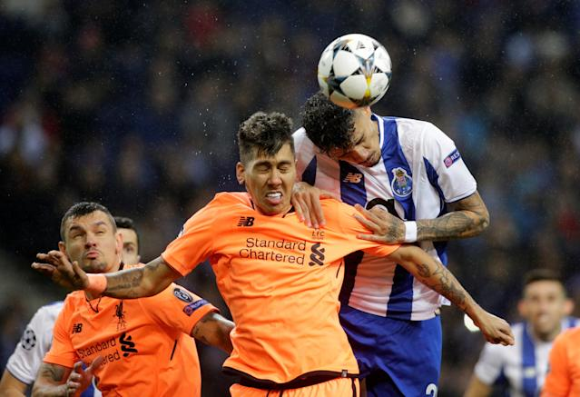 Soccer Football - Champions League Round of 16 First Leg - FC Porto vs Liverpool - Estadio do Dragao, Porto, Portugal - February 14, 2018 Porto's Tiquinho Soares in action with Liverpool's Roberto Firmino REUTERS/Miguel Vidal