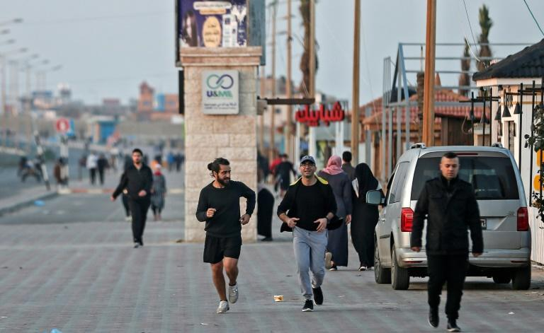 Palestinians exercise at dawn in Gaza; as the pandemic has dragged on, larger crowds are using Gaza's Mediterranean coastline to relieve some stress