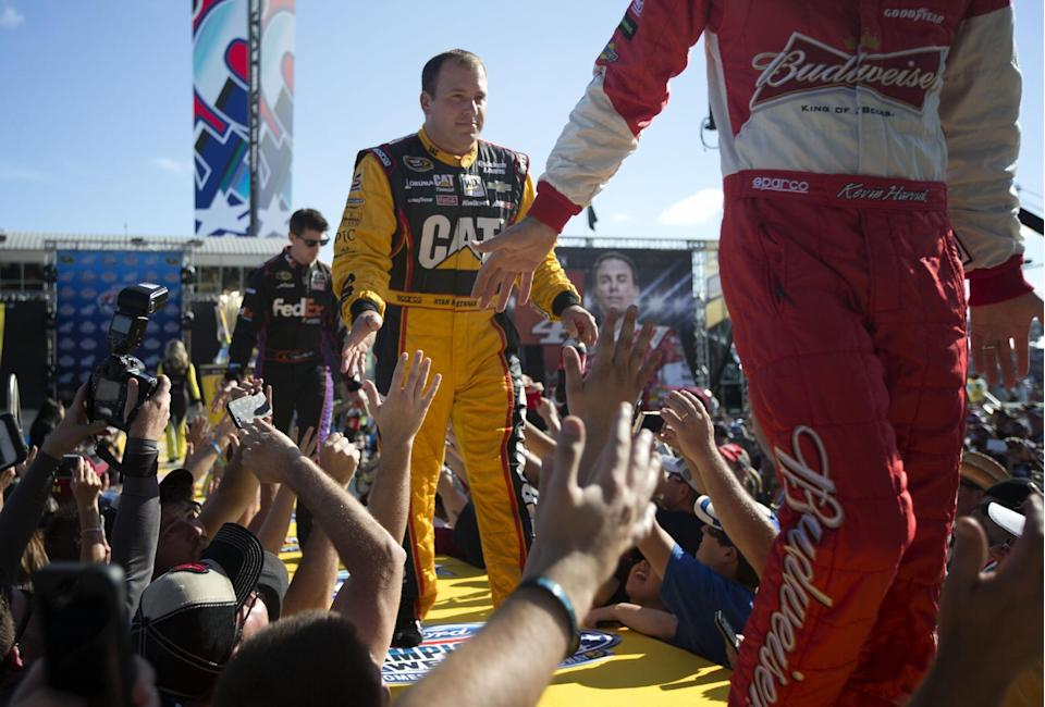 Ryan Newman greets fans before the NASCAR Sprint Cup championship series auto race, Sunday, Nov. 16,2014 in Homestead, Fla. (AP Photo/J Pat Carter)