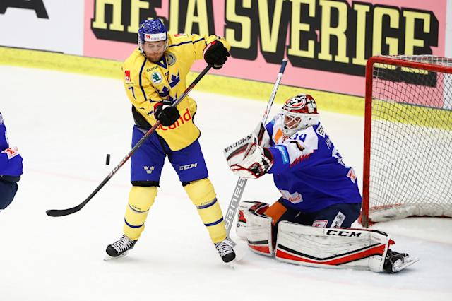 Ice Hockey - 2018 Euro Hockey Challenge - Sweden v Slovakia - Norrkoping, Sweden - April 5, 2018 - Sweden's Patrick Cehlin and Slovakia's goalkeeper David Hrenak in action. TT News Agency/Stefan Jerrevang/ via REUTERS ATTENTION EDITORS - THIS IMAGE WAS PROVIDED BY A THIRD PARTY. SWEDEN OUT. NO COMMERCIAL OR EDITORIAL SALES IN SWEDEN