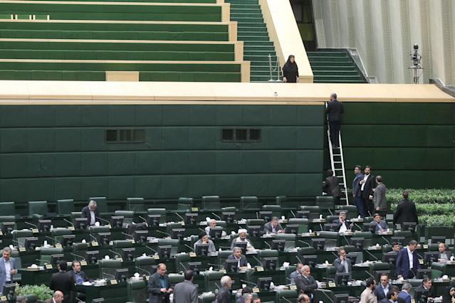 <p>Iranian lawmakers sit inside the parliament during an attack in central Tehran, Iran, June 7, 2017. (Photo: TIMA via Reuters) </p>