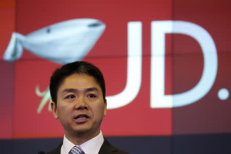 Liu, CEO and founder of JD.com, speaks before ringing the opening bell at the NASDAQ Market Site building in New York