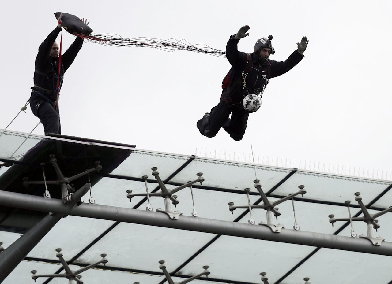 <p>A skydiver jumps off the stadium roof to deliver the match ball for the Bundesliga match between Hertha BSC Berlin and Bayer 04 Leverkusen in Berlin (Rex features) </p>