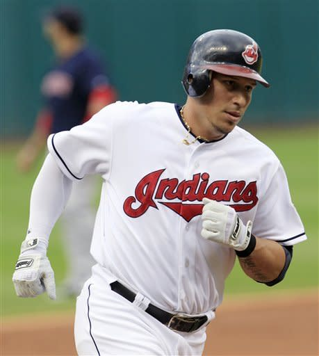 Cleveland Indians' Asdrubal Cabrera runs the bases after hitting a solo home run in the first inning of a baseball game against the Boston Red Sox, Friday, Aug. 10, 2012, in Cleveland. (AP Photo/Tony Dejak)