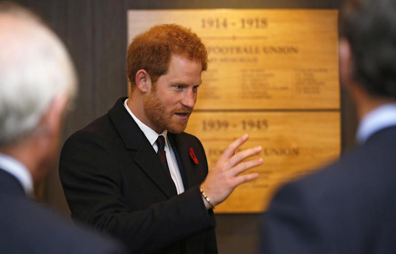 Britain's Prince Harry, meets contributors to the RFU projects commemorating the First World War after arriving for the Autumn International England vs South Africa rugby match at Twickenham stadium in London, Saturday, Nov. 12, 2016. (AP Photo/Alastair Grant, Pool)