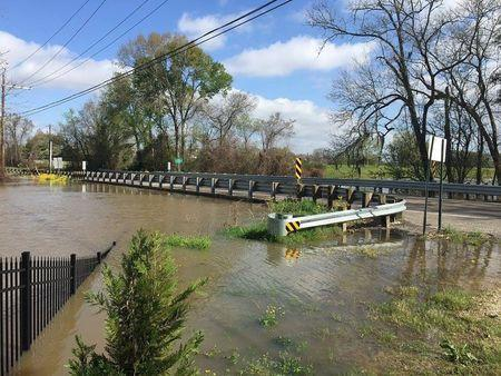 Floodwaters leave the banks of Bayou Manchac, an 18-mile-long bayou in southeast Louisiana near Baton Rouge, in this picture from the Louisiana Department of Transportation and Development (DOTD) taken March 14, 2016. REUTERS/Louisiana Department of Transportation and Development/Handout via Reuters