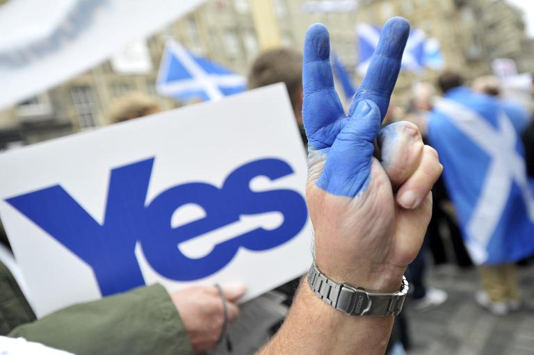 A supporter of Scottish independence on September 21, 2013 flashes the victory sign at a rally in Edinburgh