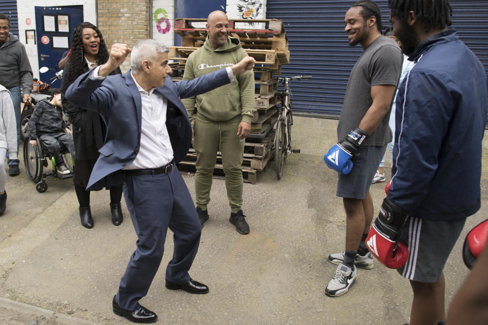 Labour's Mayor of London Sadiq Khan, foreground centre, gestures, during his visit to Dwaynamics Boxing Club while on the campaign trail for the London Mayoral election, in Brixton, south London, Thursday April 8, 2021. (Stefan Rousseau/PA via AP)