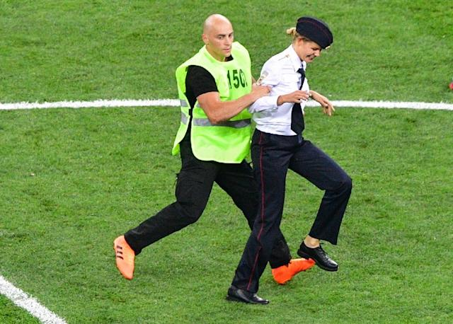 Four Pussy Riot band members were arrested for storming the field during the World Cup final (AFP Photo/Mladen ANTONOV)
