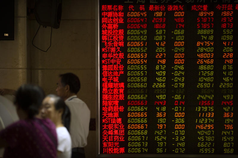 Chinese investors use computer terminals as they monitor stock prices at a brokerage house in Beijing, Wednesday, Sept. 11, 2019. Asian shares were mostly higher Wednesday, cheered by a rise on Wall Street amid some signs of easing tensions between the U.S. and China on trade issues. (AP Photo/Mark Schiefelbein)