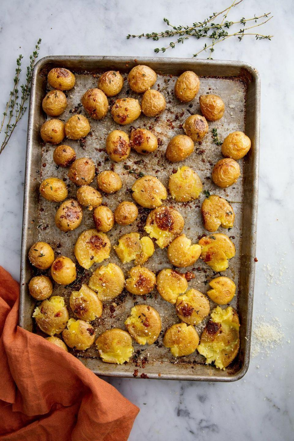 """<p>Step aside, mashed potatoes. These tasty, garlicky smashed potatoes will be taking center stage this year. </p><p><strong><em>Get the recipe at <a href=""""https://www.delish.com/cooking/recipe-ideas/recipes/a49007/garlic-smashed-potatoes-recipe/"""" rel=""""nofollow noopener"""" target=""""_blank"""" data-ylk=""""slk:Delish"""" class=""""link rapid-noclick-resp"""">Delish</a>. </em></strong><br></p>"""