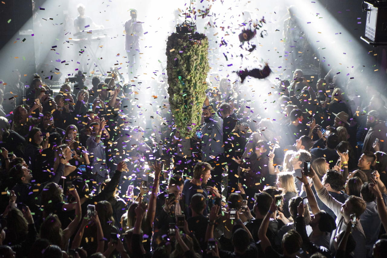<p>A depiction of a cannabis bud hangs from the ceiling as a band plays at Leafly's countdown party in Toronto, Tuesday, Oct. 16, 2018, as they prepare to mark the legalization of Cannabis across Canada.<br />(Photo from Chris Young, The Canadian Press) </p>