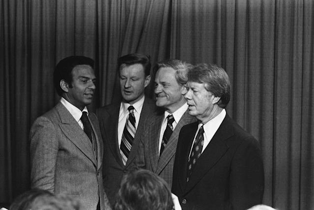 <p>President-elect Jimmy Carter talks with his new appointees after they were named during a news conference in Plains, Ga., on Thursday Dec. 17, 1976. They are from left: Rep. Andrew Young (D.Ga.) to be U.N Ambassador; Zbigniew Brzezinski, head of the National Security Council; Charles Schultze, Chairman of the Economic Advisors council. (Photo: AP) </p>