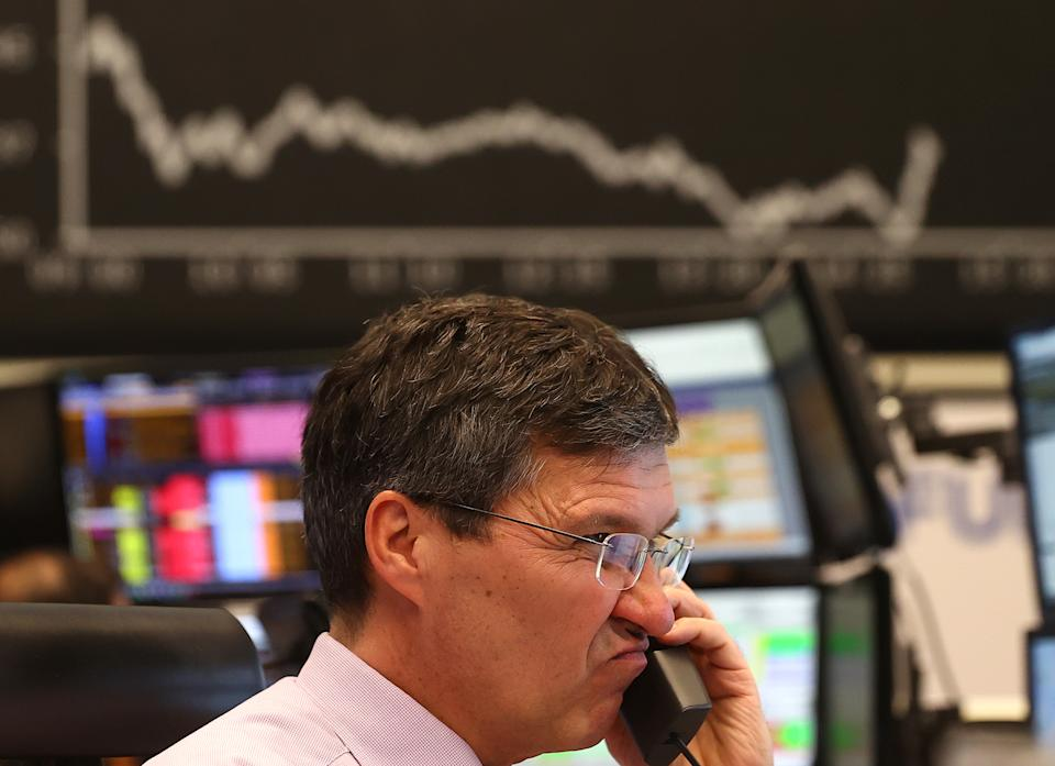 A stock trader looks at his screens during a trading session at Frankfurt's stock exchange as markets react on the coronavirus disease (COVID-19) at the stock exchange in Frankfurt, Germany, March 16, 2020.   REUTERS/Kai Pfaffenbach