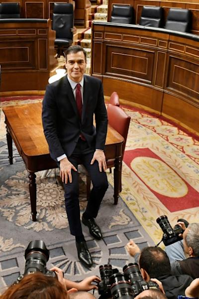 Invested at last but Socialist Prime Minister Pedro Sanchez knows it won't be an easy ride (AFP Photo/PIERRE-PHILIPPE MARCOU)