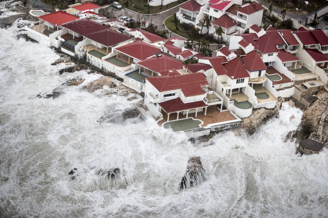 <p>Few of the homes that remained intact in the aftermath of Hurricane Irma, in St. Maarten. Irma cut a path of devastation across the northern Caribbean, leaving thousands homeless after destroying buildings and uprooting trees, Sept. 6, 2017. (Photo: Gerben Van Es/Dutch Defense Ministry via AP) </p>
