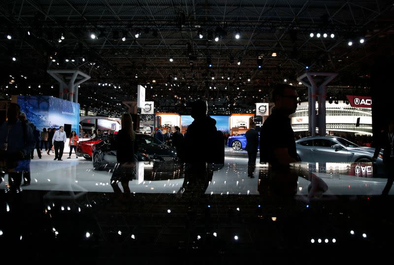 Members of the media attend the New York Auto Show in New York