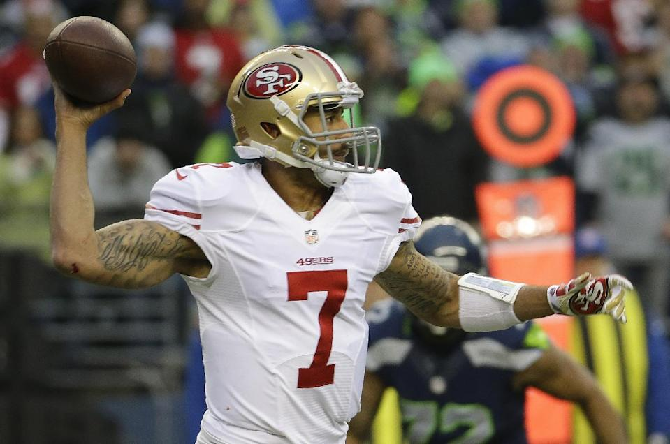 San Francisco 49ers quarterback Colin Kaepernick throws during the first half of the NFL football NFC Championship game against the Seattle Seahawks, Sunday, Jan. 19, 2014, in Seattle. (AP Photo/Ted S. Warren)