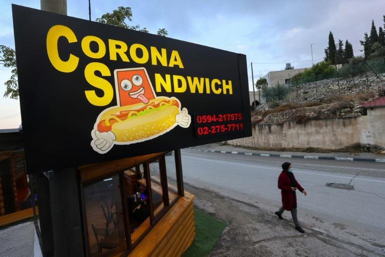 """The """"Corona Sandwich"""" restaurant, close to the Church of the Nativity in the occupied West Bank town of Bethlehem, was opened amid a collapse of the tourist industry as tour guide Raed Bannura looked for an alternative source of income"""
