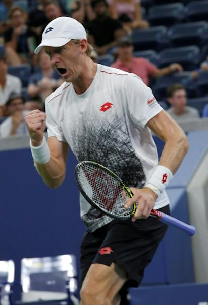Moving on: Kevin Anderson of South Africa celebrates against Denis Shapovalov