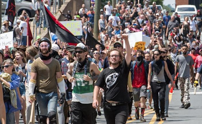 Protesters march in Charlottesville, Virginia on August 12, 2017 (AFP Photo/PAUL J. RICHARDS)