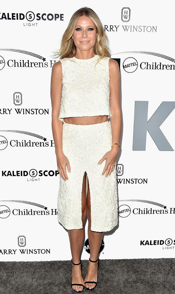 Gwyneth Paltrow — on the red carpet for UCLA Mattel Children's Hospital presents Kaleidoscope 5 in Culver City, Calif., on Sunday — kept her legs mostly covered, but showed a little toned tummy. (Photo: Frazer Harrison/Getty Images)