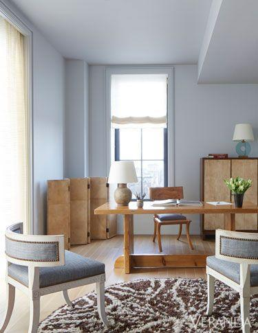 <p>This beautiful office space feels warm and inviting and will help keeps it owner relaxed on even the busiest of days. A light grey hue that skews blue evokes a sunny day, while a mix of natural materials welcomes the outside in. </p>