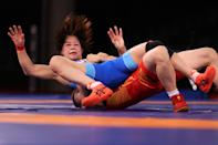 <p> Mayu Mukaida of Team Japan competes against Qianyu Pang of Team China during the Women's Freestyle 53kg Gold Medal Match on day fourteen of the Tokyo 2020 Olympic Games at Makuhari Messe Hall on August 06, 2021 in Chiba, Japan. (Photo by Ezra Shaw/Getty Images)</p>