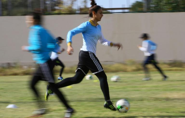 The Libyan women's football team faces the challenges of being in a conservative society where it is frowned upon to play sports in public