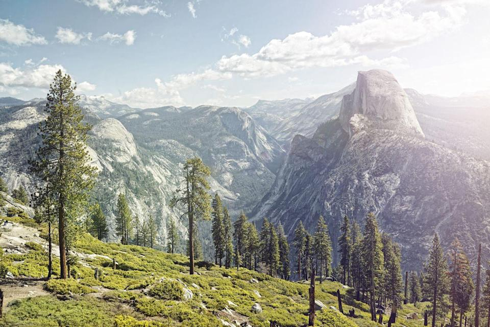 """<p><a href=""""https://www.nps.gov/yose/index.htm"""" rel=""""nofollow noopener"""" target=""""_blank"""" data-ylk=""""slk:Yosemite National Park"""" class=""""link rapid-noclick-resp""""><strong>Yosemite National Park </strong></a><br><br>Like Alaska, California has a lot of national parks to choose from, and you can't go wrong with a trip to Alcatraz, Death Valley, or Joshua Tree. And the Golden Gate National Recreation Area was the <a href=""""https://www.nps.gov/aboutus/visitation-numbers.htm"""" rel=""""nofollow noopener"""" target=""""_blank"""" data-ylk=""""slk:most visited spot in the National Park Service"""" class=""""link rapid-noclick-resp"""">most visited spot in the National Park Service</a> in 2019. But if you are looking for a big old national park experience, head to Yosemite. There are waterfalls around practically every corner and mountains that will take your breath away, and ancient Sequoia trees that practically glow in the sunshine. </p>"""