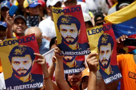 FILE PHOTO: Placards depicting Venezuela's opposition leader Leopoldo Lopez are seen during a rally against Venezuelan President Maduro's government in Caracas, Venezuela July 9, 2017. REUTERS/Andres Martinez Casares/File Photo