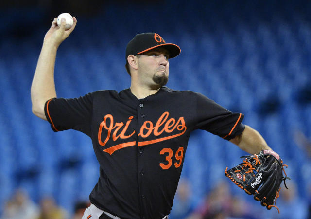 Baltimore Orioles starting pitcher Jason Hammel works against the Toronto Blue Jays during the first inning of a baseball game in Toronto on Friday, Sept. 13, 2013. (AP Photo/The Canadian Press, Nathan Denette)