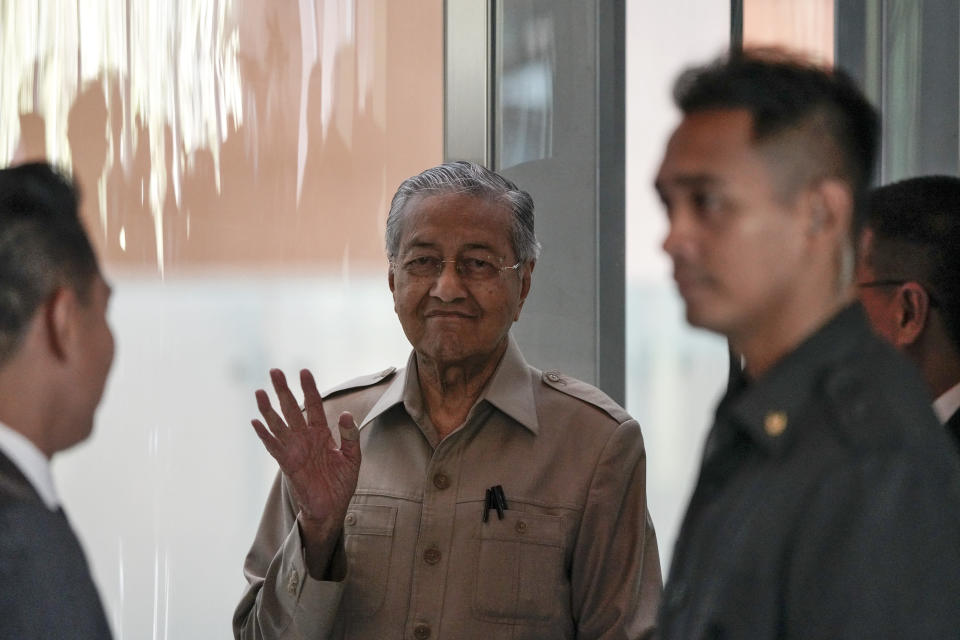 Malaysia's interim leader Mahathir Mohamad, center, waves as he leaves after delivering a speech at the committee on the exercise of the inalienable rights of the Palestinian people, in Kuala Lumpur, Malaysia, Friday, Feb. 28, 2020. The speaker of Malaysia's House rejected Mahathir Mohamad's call for a vote next week to chose a new premier, deepening the country's political turmoil after the ruling alliance collapsed this week. (AP Photo/Vincent Thian)