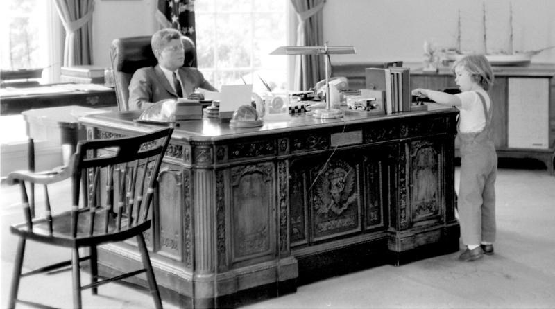 FILE - This May 16, 1962 photograph released by the John F. Kennedy Presidential Library and Museum in Boston shows President John F. Kennedy behind his desk while visited by his daughter Caroline in the Oval Office at the White House in Washington. The daughter of President John F. Kennedy says his spirit lives on even though his life was cut short. Kennedy, who is also the new U.S. ambassador to Japan, said in an interview with Japan's Yomiuri newspaper that she often meets people who tell her they were inspired by her father. She said it's a reminder that we all have a duty to work together for a better world. (AP Photo/John F. Kennedy Presidential Library and Museum, Robert Knudsen) NO SALES