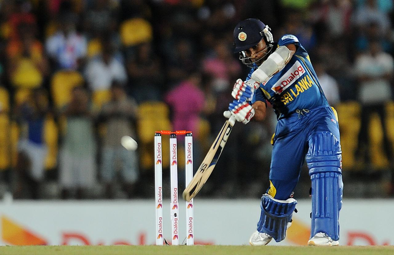 Sri Lankan batsman Mahela Jayawardene plays a shot during the third and final Twenty20 cricket match between Sri Lanka and South Africa at the Suriyawewa Mahinda Rajapakse International Cricket Stadium in the southern district of Hambantota on August 6, 2013. AFP PHOTO/ LAKRUWAN WANNIARACHCHI
